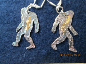 SQUTCHIN'. These fine silver and 22 carat gold earrings are just the thing for the discerning hairy hominid seeker. Do they represent sasquatch, the yeti, or even the swamp ape? That's for you to decide. ;-)